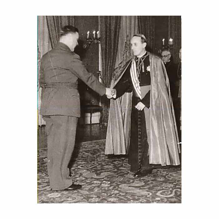 Croatian fascist leader Ante Pavelic awarding the Archbishop A. Stepinac the highest honor